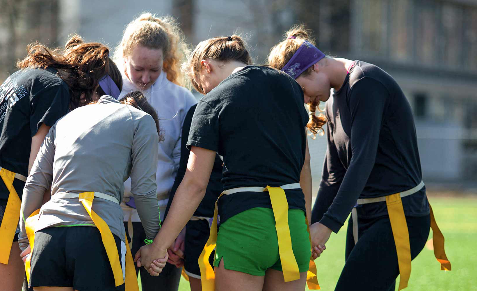A prayer circle before an intramural match